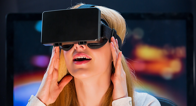 blonde woman trying Virtual Reality headset