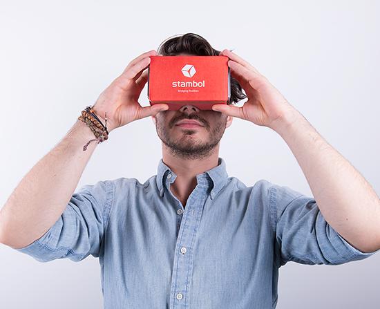 male model holding Google Cardboard with Stambol logo