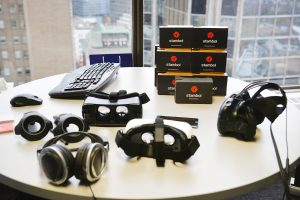 Different Virtual Reality Headsets on table