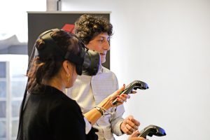 Woman while trying HTC Vive VR headset
