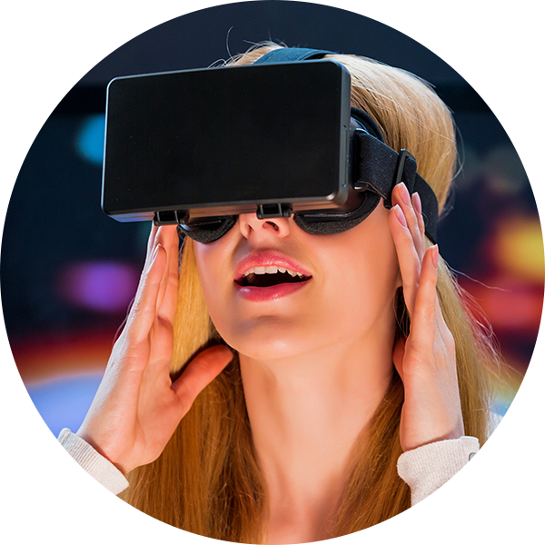 woman showing excitement with virtual reality headset