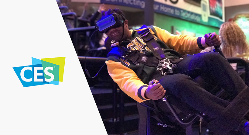 person on motion platform trying VR at CES 2017