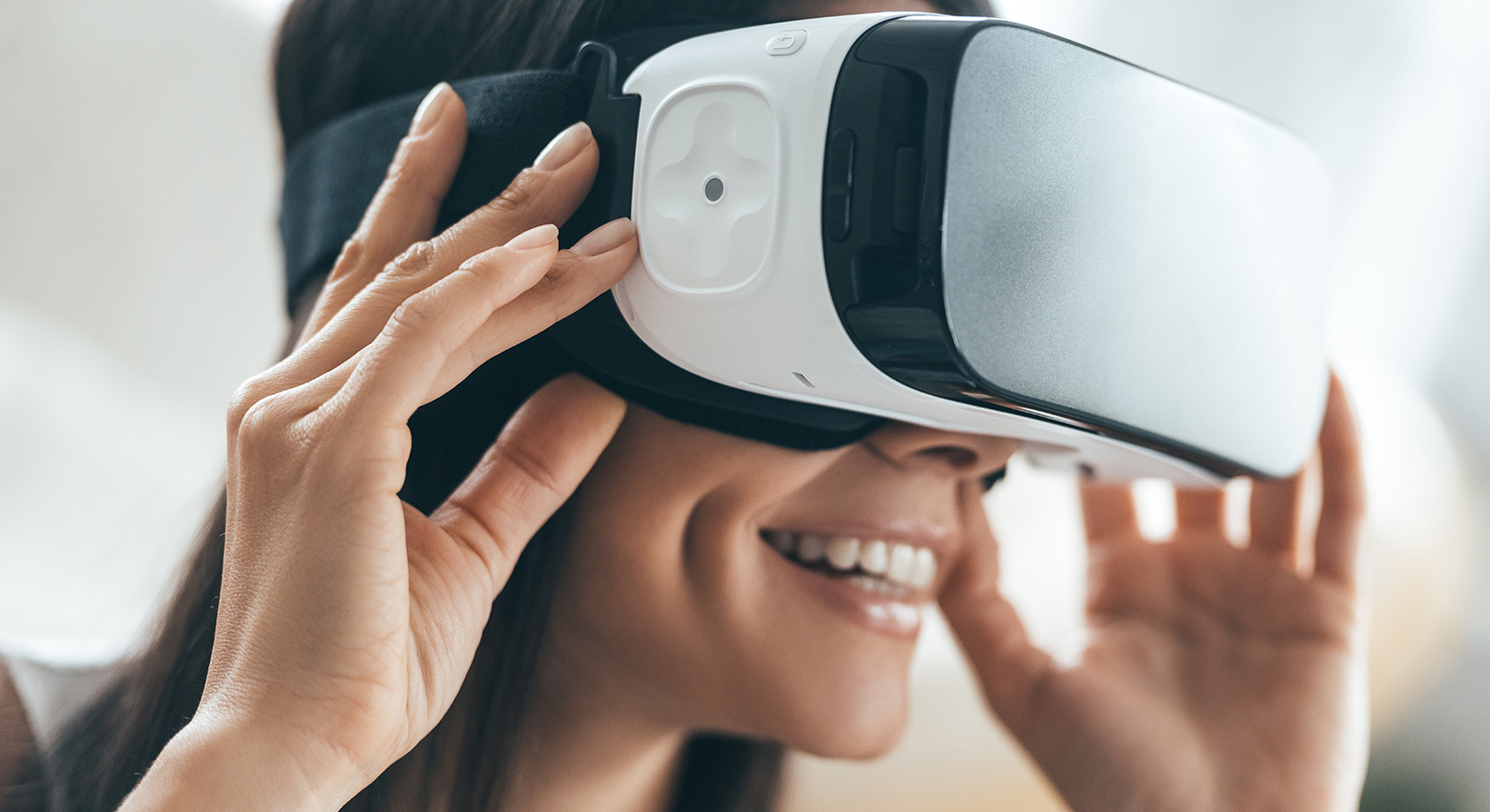 Woman wearing virtual reality headset and smiling