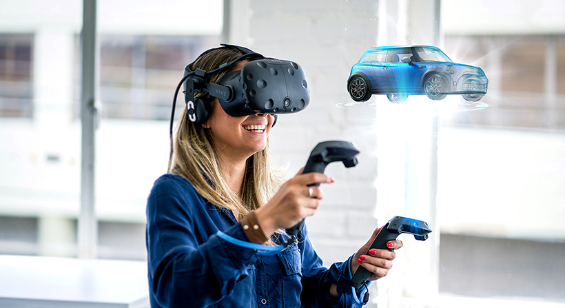Young female wearing VR headset and visualizing a blue car