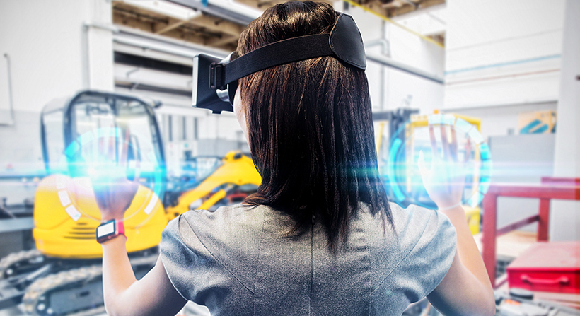 Young woman using VR Headset for job training in warehouse