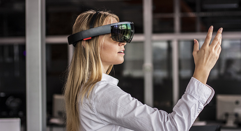 Young, blonde female wearing hololens headset