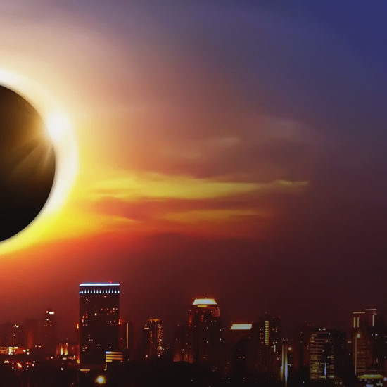 Total Solar Eclipse over a city view