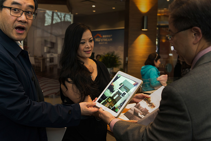 Guests trying Augmented Reality for Park Grand real estate at a presentation centre by Stambol Studios