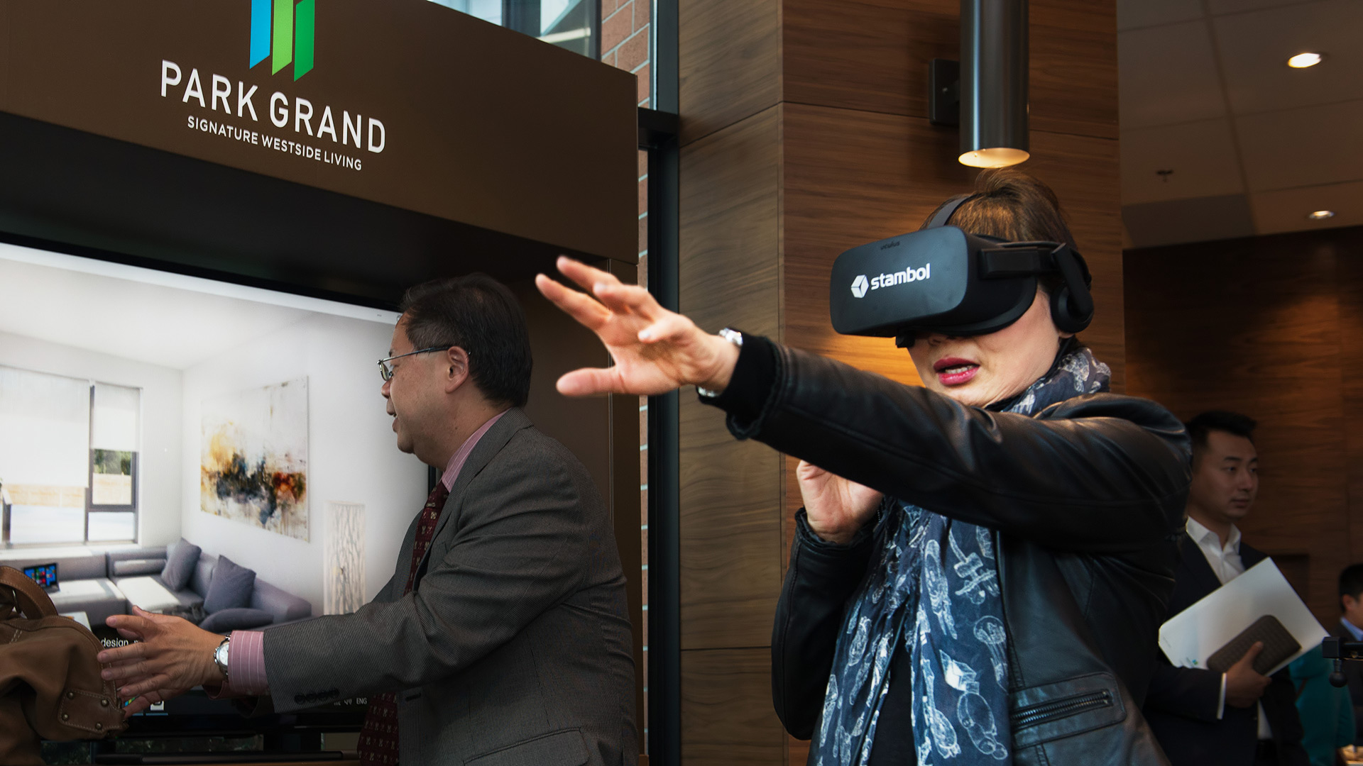 woman trying Park Grand for real estate in virtual reality by Stambol Studios