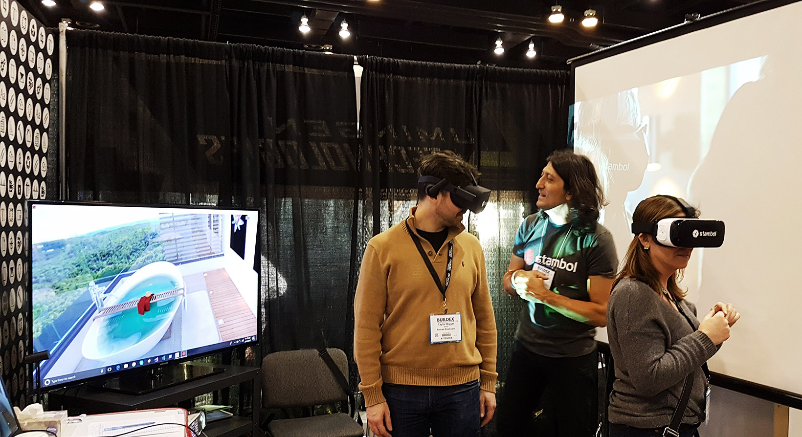 Couple of visitors are trying virtual reality at BuildEx Vancouver