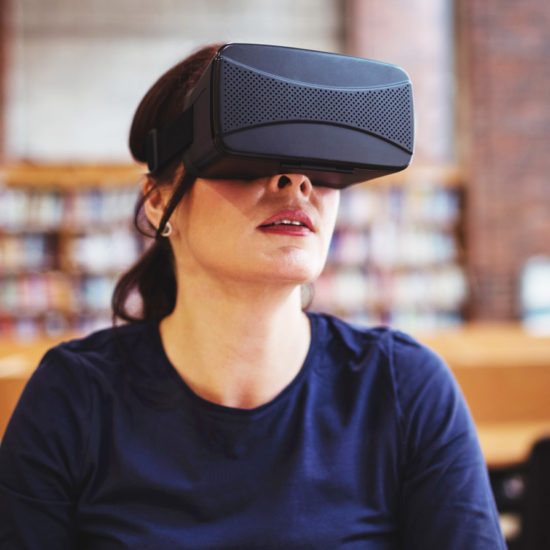Mature student using virtual reality headset in public library