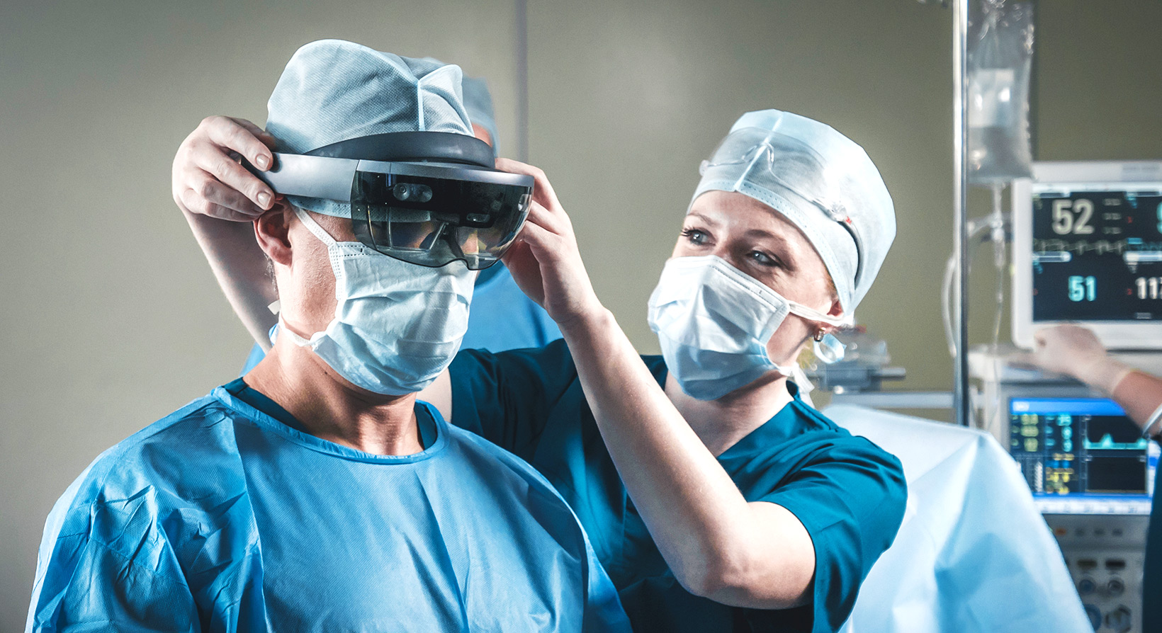 a nurse helping surgeon to wear hololens in operating room
