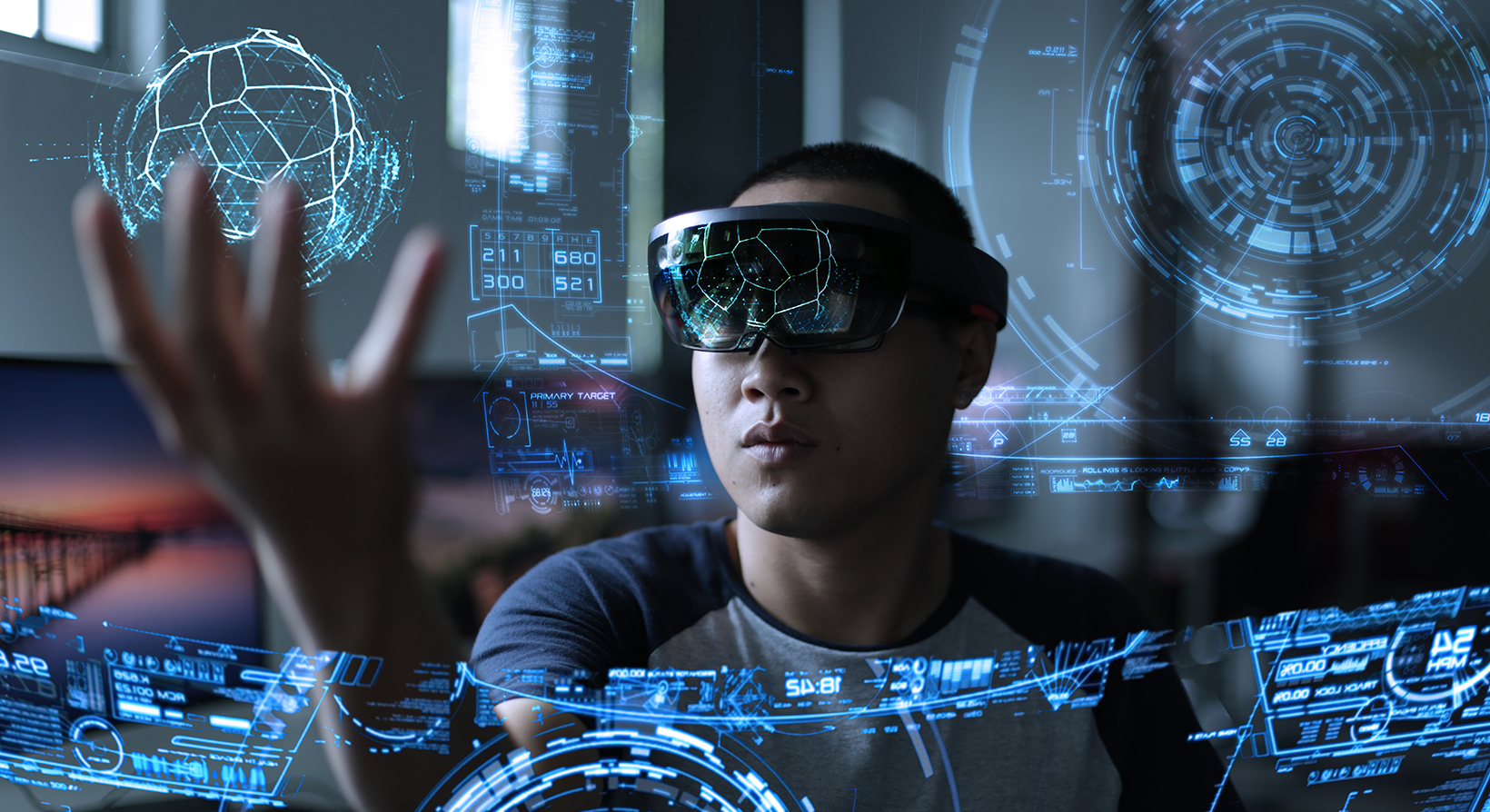 man wearing hololens and playing with a holographic object