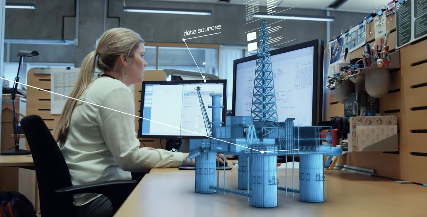 Female Engineer at her desk working with digital twin