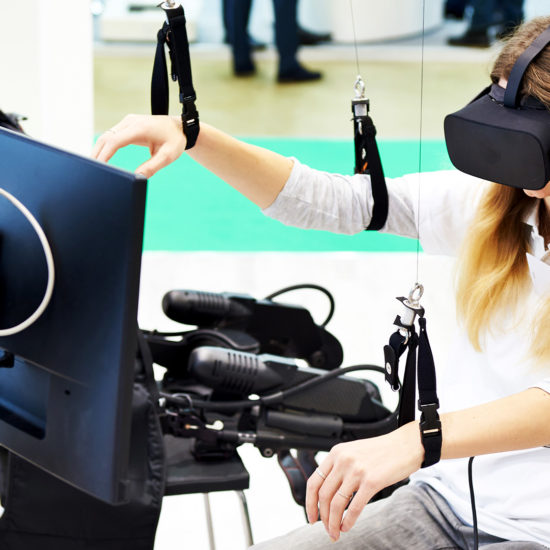 female patient is in virtual reality device for rehabilitation
