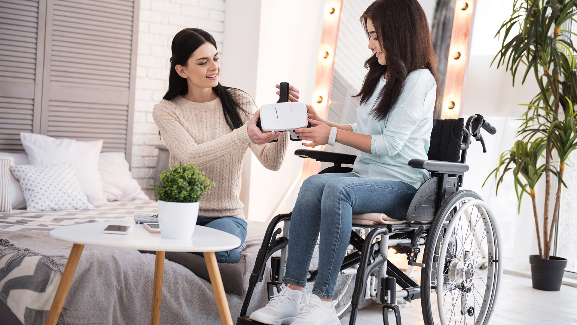 Female patient trying virtual reality in a wheelchair