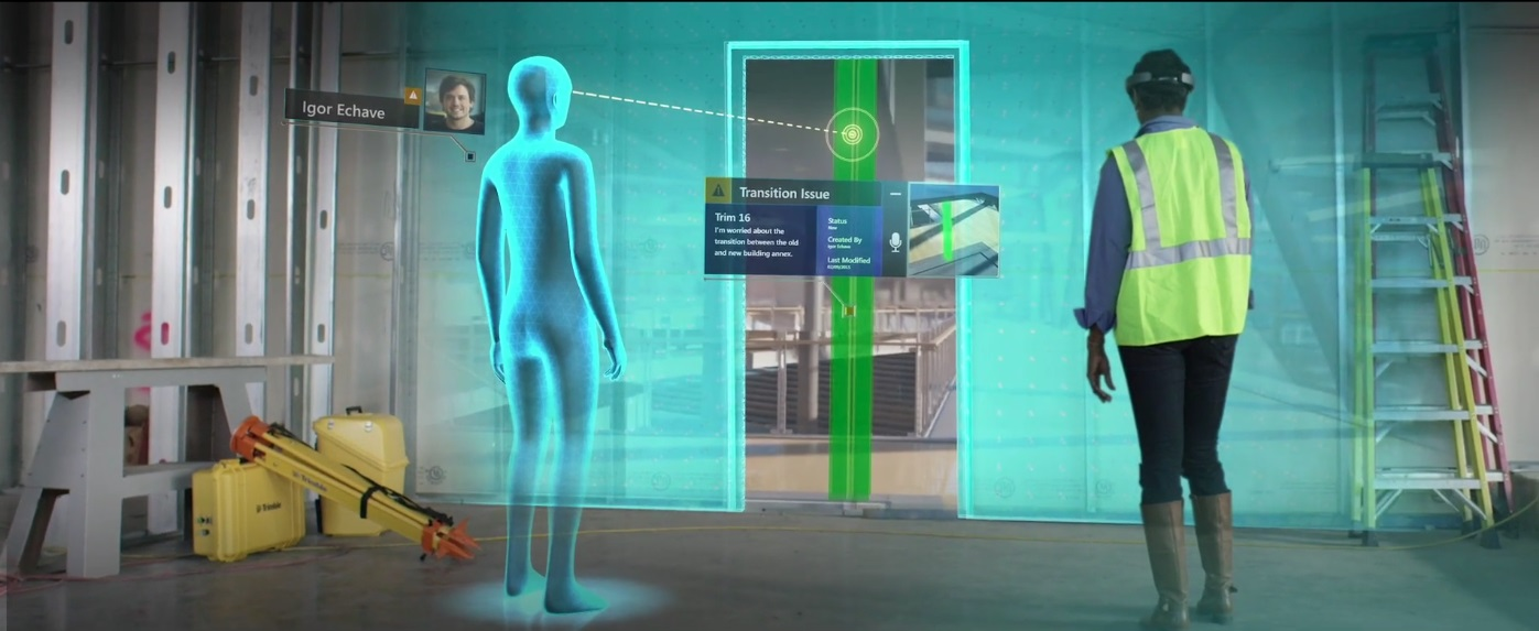 Woman wears Microsoft HoloLens headset while looking at holograms at a construction site