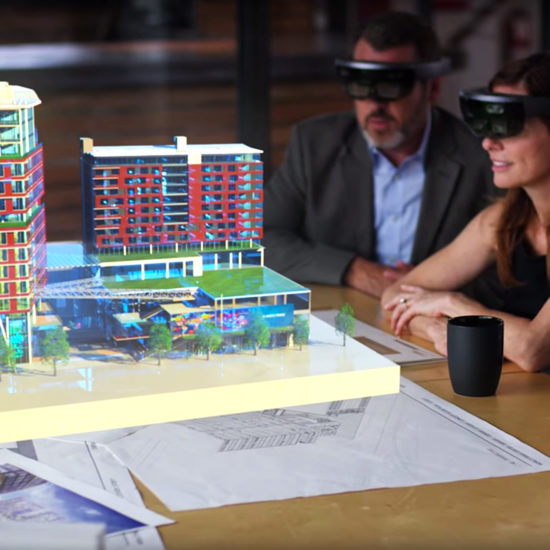 Architects look at a holographic building with Microsoft Hololens