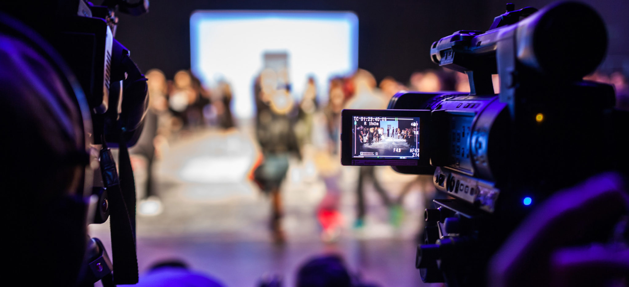 cameraman shooting fashion show for live broadcasting