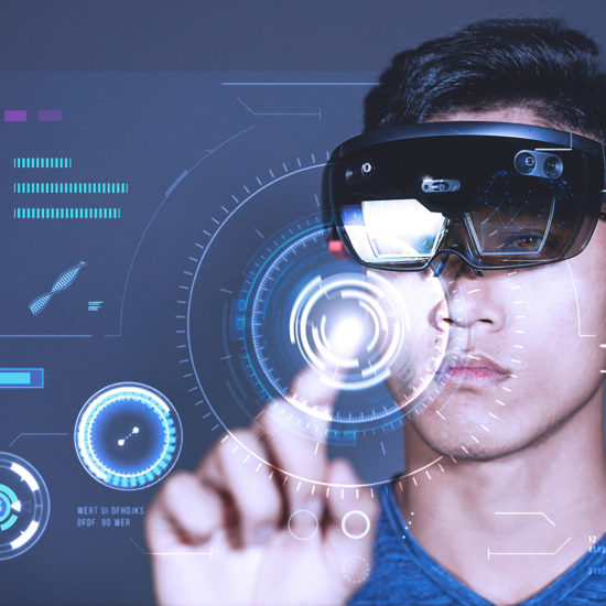 Young Man wearing Hololens pressing virtual buttons on business charts
