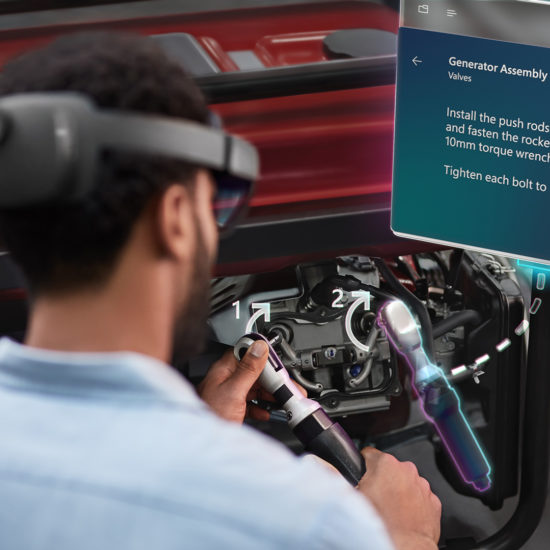 worker using HoloLens 2 in Microsoft Dynamics Guides mixed reality training application for enterprise