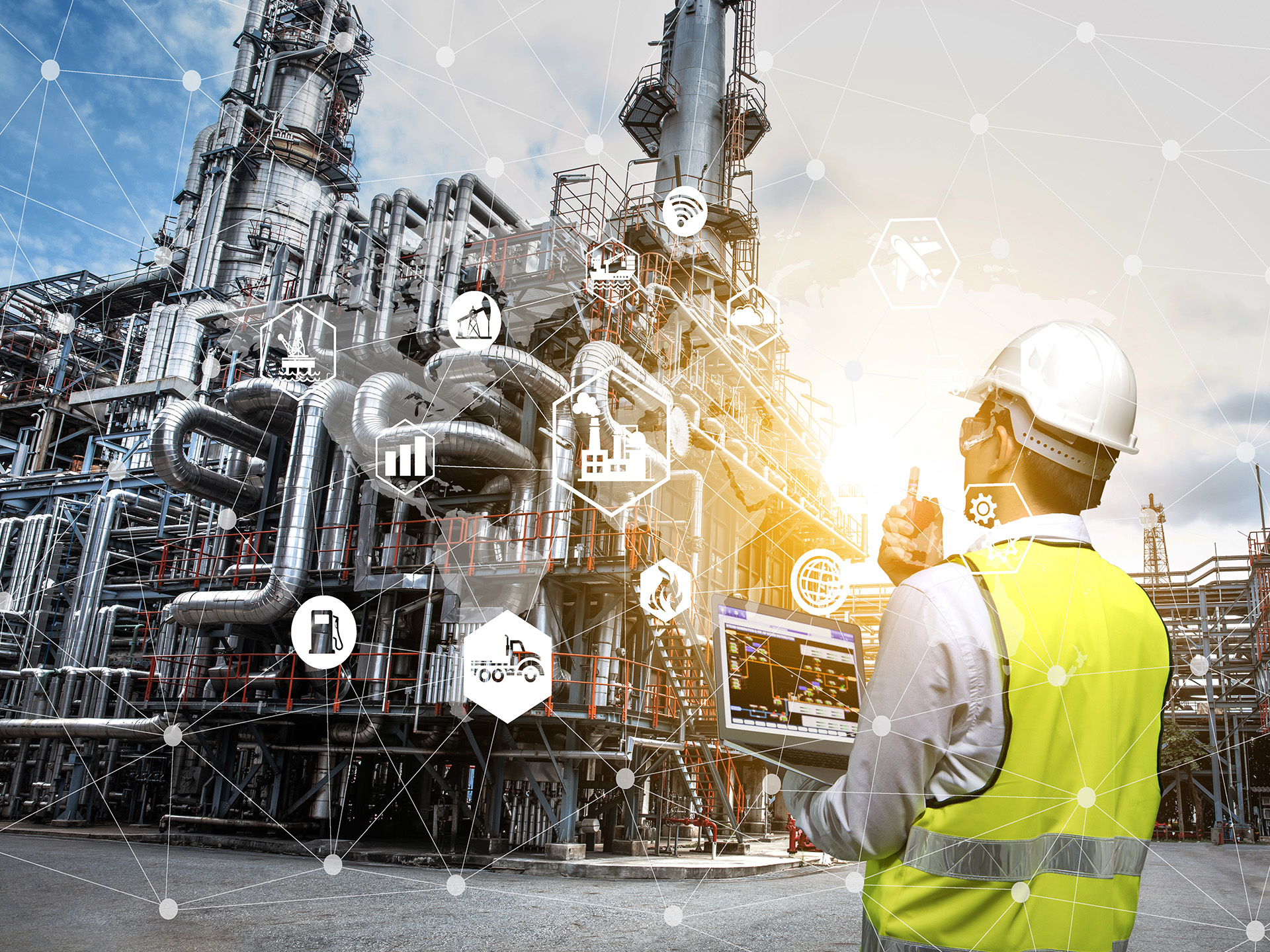 Engineer holding walkie talkie are working orders the oil and gas refinery plant. Industry petrochemical concept image and icon connecting networking using augmented reality technology.