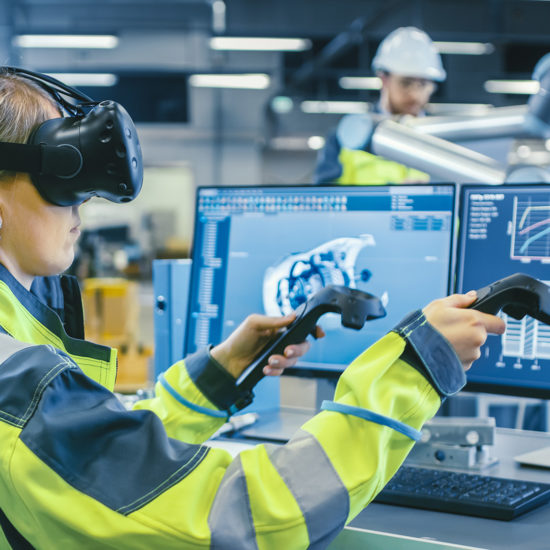 female factory worker wearing a vr headset and holding controllers for an industrial training application in an enterprise setting