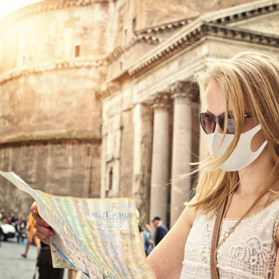 tourist visits the map with a rome and a pantheon in a mask