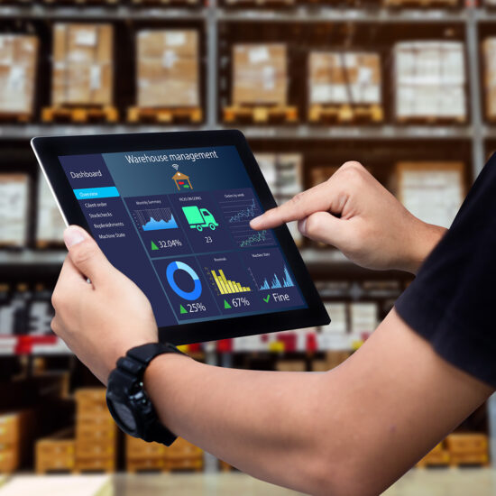 worker using smart warehouse management system for automation