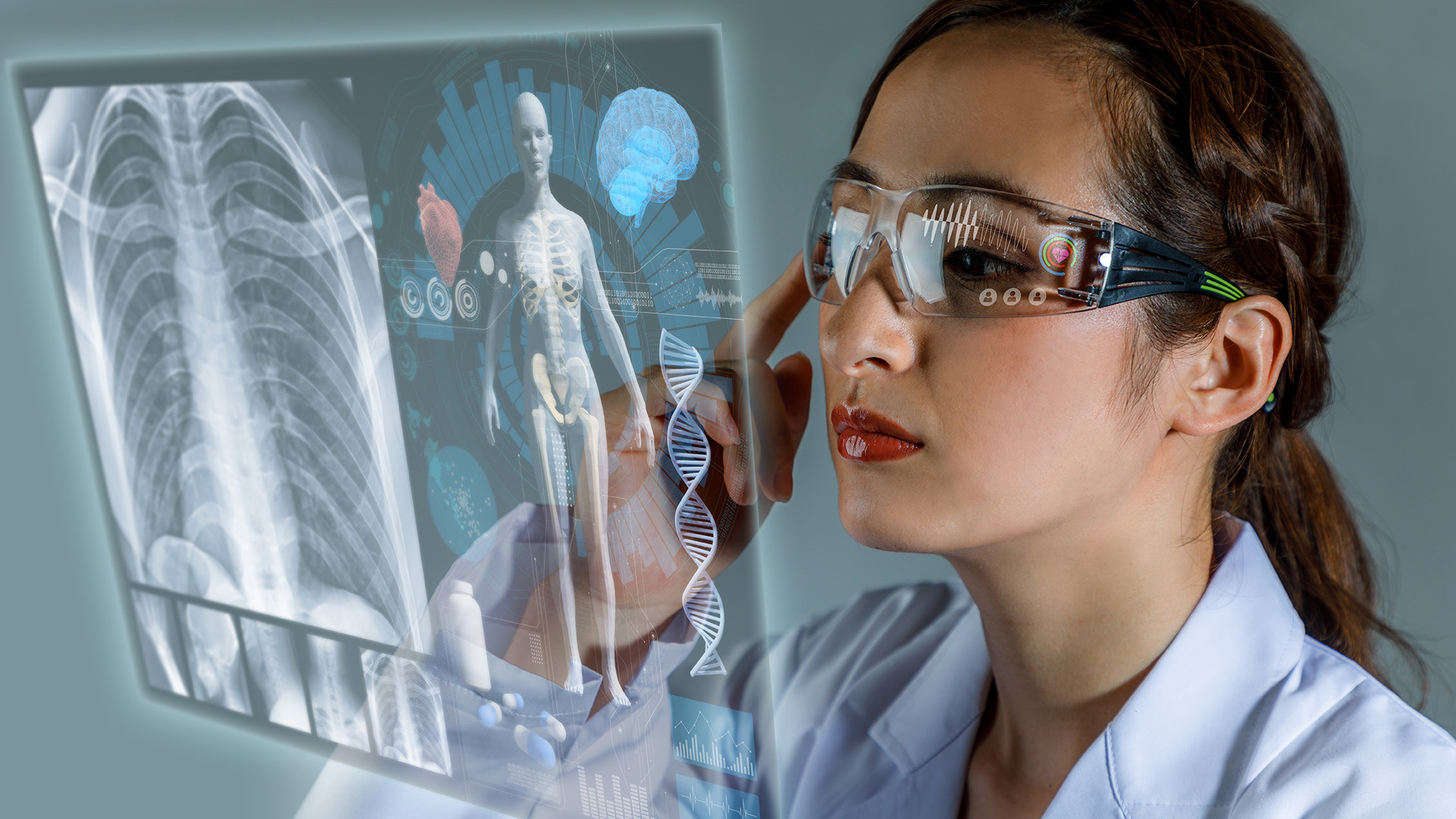 young female doctor looking at hologram screen displaying electronic medical records